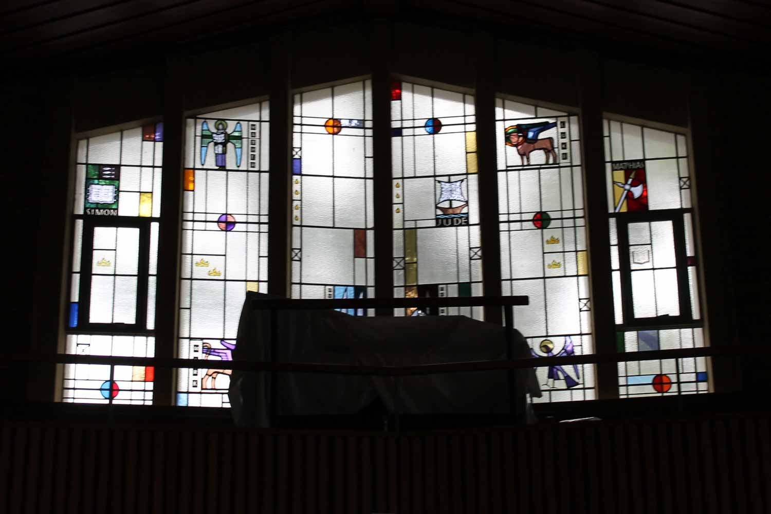 Coburg Uniting Church Melbourne, Our Beliefs 3: stained glass windows with a darkened backdrop