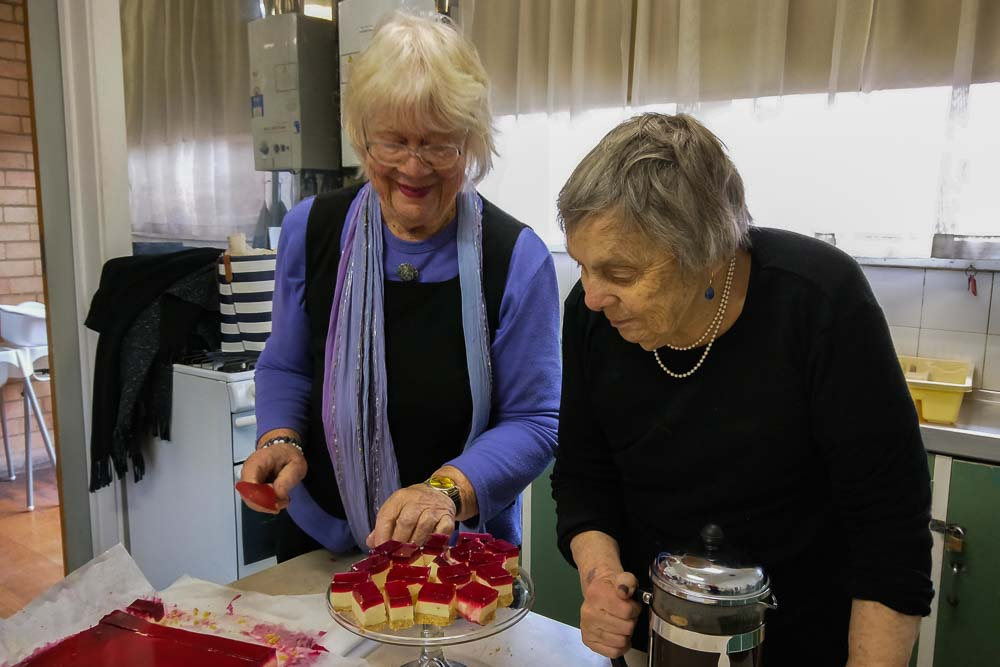 Coburg Uniting Church Melbourne, Coffee Chat n Play, About Us and Groups pages: Two women preparing jelly slice